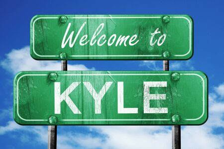 green road sign: Welcome to kyle green road sign