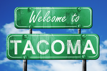 tacoma: Welcome to tacoma green road sign Stock Photo