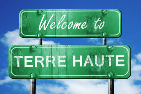haut: Welcome to terre haut green road sign Stock Photo