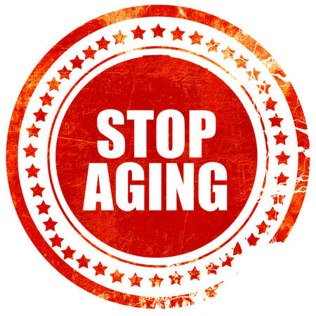 anti ageing: stop aging, isolated red stamp on a solid white background