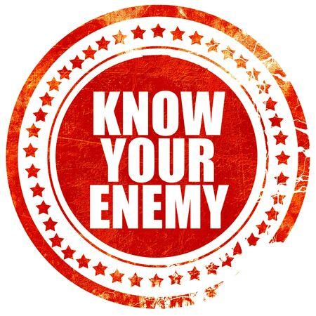 competitividad: conoce a tu enemigo, sello rojo aislado en un fondo blanco sólido Foto de archivo