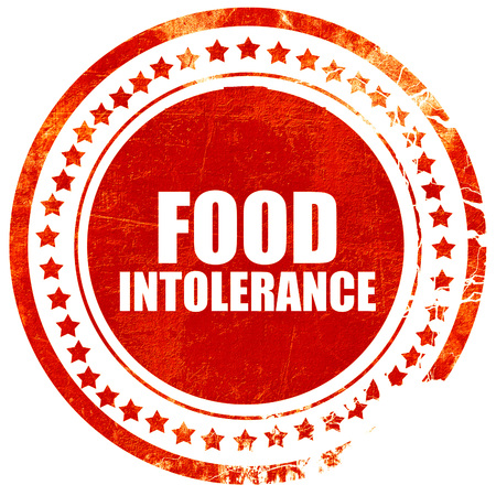 intolerancia: food intolerance, isolated red stamp on a solid white background