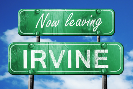 leaving: Now leaving irvine road sign with blue sky