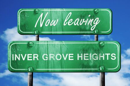 leaving: Now leaving inver grove heights road sign with blue sky