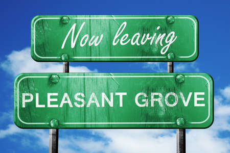pleasant: Now leaving pleasant grove road sign with blue sky Stock Photo