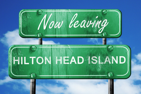 leaving: Now leaving hilton head island road sign with blue sky