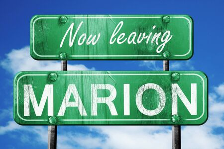 marion: Now leaving marion road sign with blue sky Stock Photo