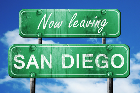 leaving: Now leaving san diego road sign with blue sky