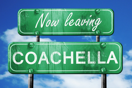 leaving: Now leaving coachella road sign with blue sky