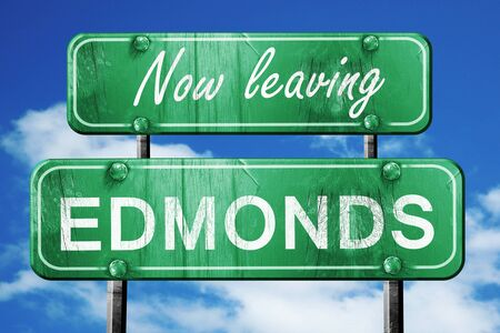 edmonds: Now leaving edmonds road sign with blue sky Stock Photo