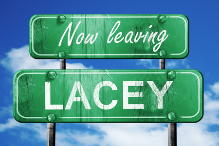 lacey: Now leaving lacey road sign with blue sky
