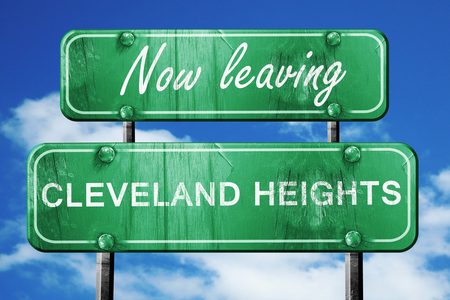 heights: Now leaving cleveland heights road sign with blue sky Stock Photo
