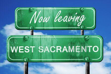 sacramento: Now leaving west sacramento road sign with blue sky Stock Photo