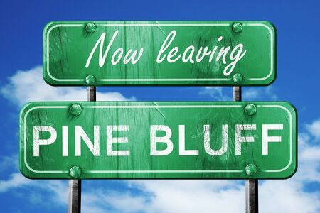 bluff: Now leaving pine bluff road sign with blue sky Stock Photo