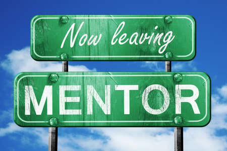 mentor: Now leaving mentor road sign with blue sky