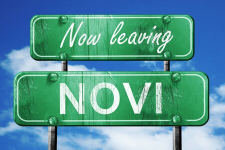 leaving: Now leaving novi road sign with blue sky Stock Photo