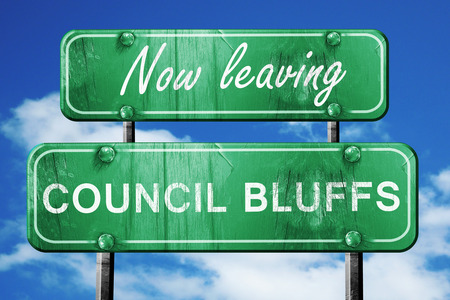 council: Now leaving council bluffs road sign with blue sky