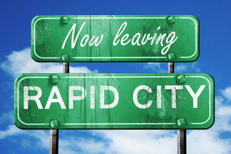 rapid: Now leaving rapid city road sign with blue sky