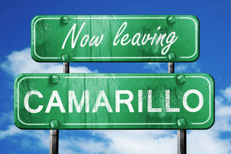 leaving: Now leaving camarillo road sign with blue sky