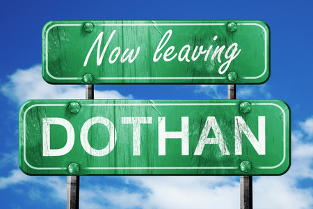 leaving: Now leaving dothan road sign with blue sky Stock Photo