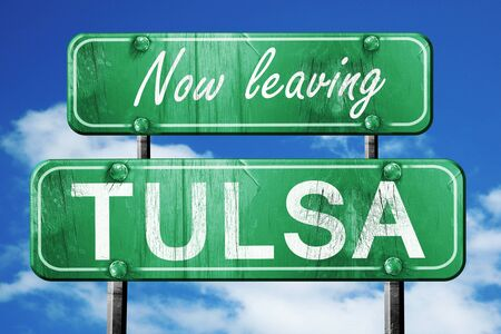 tulsa: Now leaving tulsa road sign with blue sky