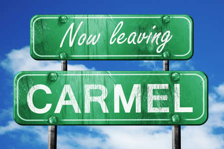 carmel: Now leaving carmel road sign with blue sky