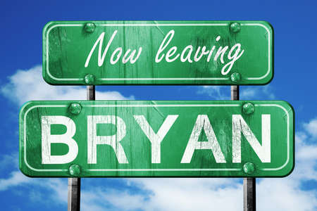 leaving: Now leaving bryan road sign with blue sky Stock Photo