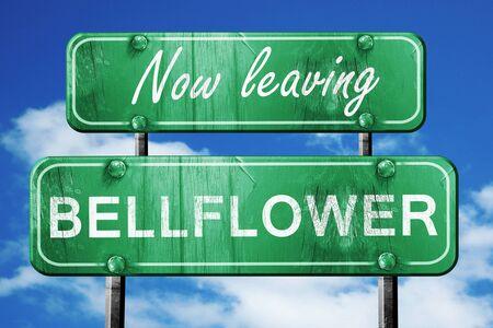 bellflower: Now leaving bellflower road sign with blue sky Stock Photo
