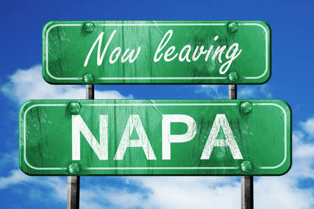 napa: Now leaving napa road sign with blue sky