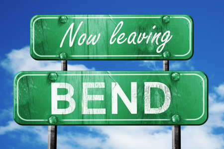 bend: Now leaving bend road sign with blue sky