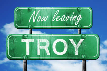 troy: Now leaving troy road sign with blue sky