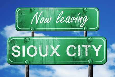 sioux: Now leaving sioux city road sign with blue sky