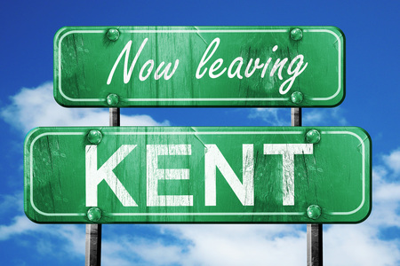 leaving: Now leaving kent road sign with blue sky Stock Photo