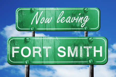 smith: Now leaving fort smith road sign with blue sky