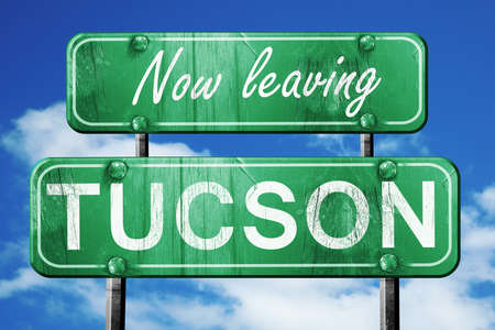 tucson: Now leaving tucson road sign with blue sky
