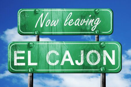 leaving: Now leaving el cajon road sign with blue sky