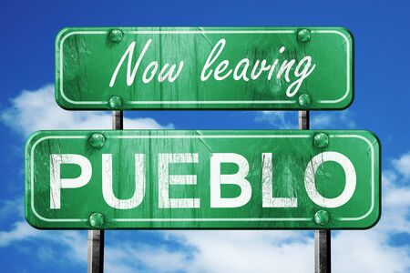 pueblo: Now leaving pueblo road sign with blue sky Stock Photo