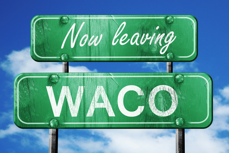 leaving: Now leaving waco road sign with blue sky Stock Photo