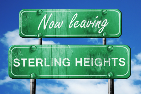 heights: Now leaving sterling heights road sign with blue sky