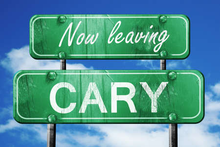 cary: Now leaving cary road sign with blue sky
