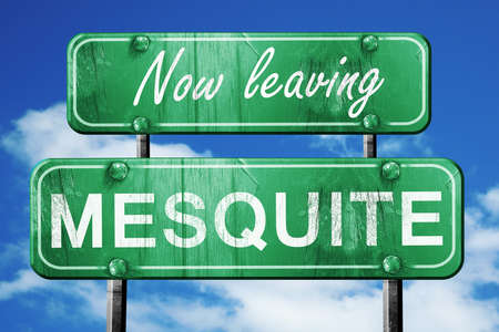 leaving: Now leaving mesquite road sign with blue sky
