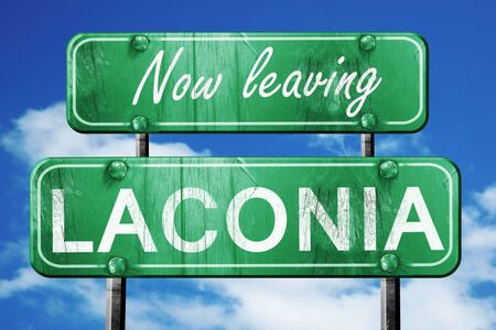 laconia: Now leaving laconia road sign with blue sky