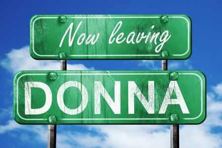 donna: Now leaving donna road sign with blue sky