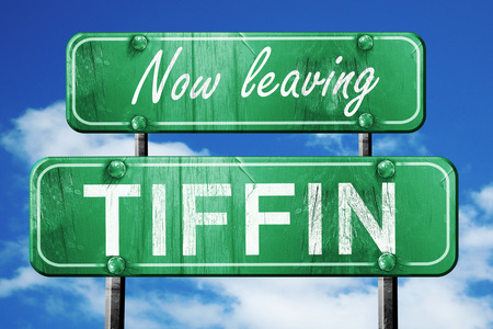 tiffin: Now leaving tiffin road sign with blue sky Stock Photo