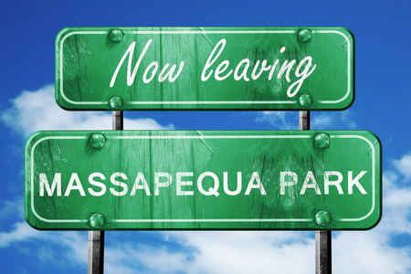 leaving: Now leaving massapequa park road sign with blue sky
