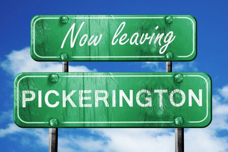 leaving: Now leaving pickerington road sign with blue sky