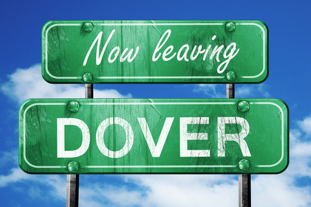 dover: Now leaving dover road sign with blue sky