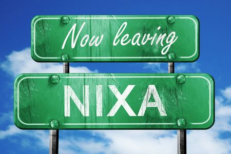 leaving: Now leaving nixa road sign with blue sky