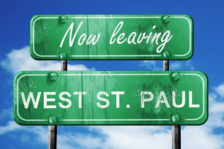 paul: Now leaving west st. paul road sign with blue sky Stock Photo