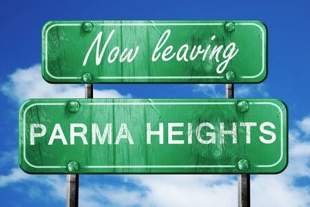 heights: Now leaving parma heights road sign with blue sky